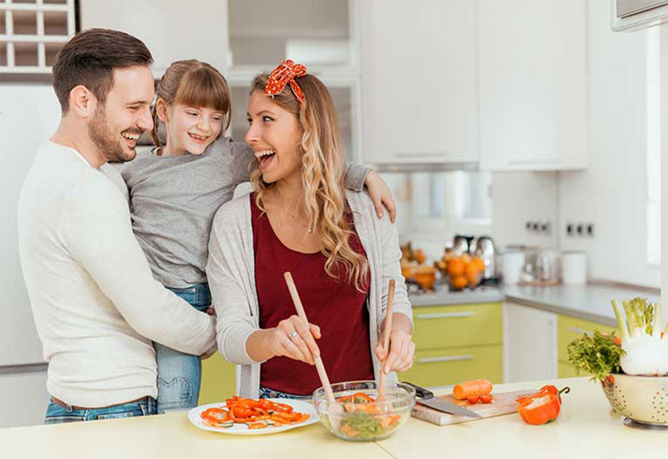 Happy Family With New Kitchen Design